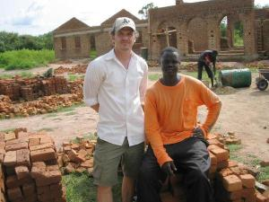 Dave Eggers and Valentino Achak Deng at the school in Marial Bai
