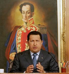 President Chavez in front of Bolivar portrait