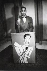 Dizzy Gillespie with a picture of Cab Calloway, 1939
