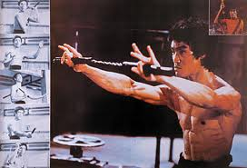 Bruce Lee with his nunchaku