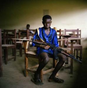 Boy with rifle, Liberia