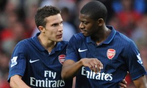 Robin van Persie consoles Abou Diaby after he scored an own goal
