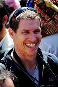 File photo of photographer and filmmaker Tim Hetherington working at a rally in the rebel stronghold of Benghazi in Libya