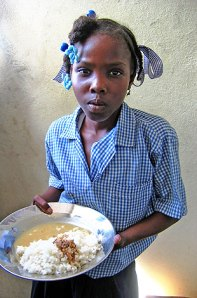 Jamaican girl with a plate of food.