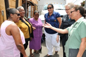 Members of the JNBS Foundation and the St. Ann's Bay Improvement Committee discuss the renovation of the town's historic clock.