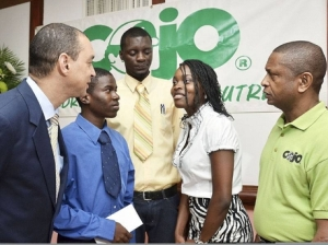COJO Chairman/Founder Gary Williams (r), GraceKennedy's Don Wehby (l) and the three scholarship recipients.