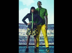 Usain Bolt and model in Jamaican Olympic gear