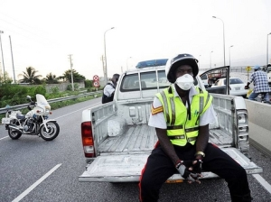 Policeman with mask on Marcus Garvey Drive, Kingston