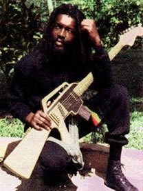 Peter Tosh and his M-16 guitar