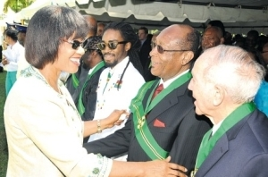 PM Portia Simpson Miller greets awardees on National Heroes Day
