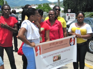 Members and clients of Eve for Life show their support for Jamaican children at a march organised by youth activists for Child Month, 2012. (My photo)