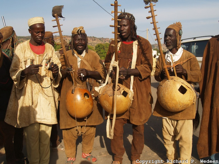 Hunter musicians in Mali with their instruments. (Photo: Richard Wedeen)
