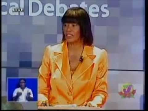 Portia speaking in her yellow at the televised National Debates in 2011.