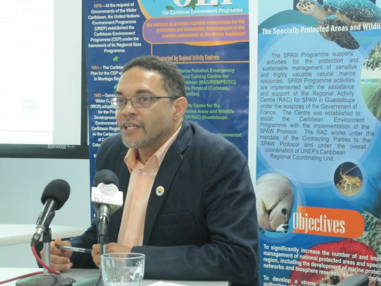 Christopher Corbin, Program Officer/Assessment and Management of Environmental Pollution, United Nations Environment Program Caribbean, speaking at Thursday's press meeting at the program's Kingston headquarters. (My photo)