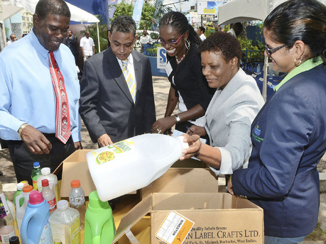 Executive director of the National Solid Waste Management Authority (NSWMA), Jennifer Edwards (second right), shows the types of plastic containers that will be collected under the Plastic Container Separation Pilot Project. (Photo: Rudolph Brown/Gleaner)