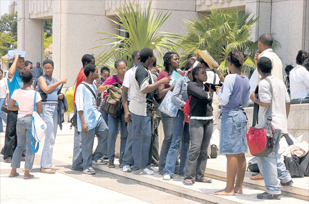 The customary long lines of students wait outside the offices of the Students Loan Bureau. (Photo: Jamaica Observer)