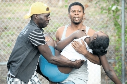 Grief, and more grief. A woman has fainted after hearing news of a relative's death (Photo: Jamaica Observer)