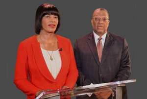 Prime Minister Portia Simpson Miller and Finance Minister Peter Phillips recording their joint broadcast yesterday. (Photo: Jamaica Information Service)