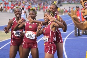 Achieving women: Athletes from Holmwood Technical High School celebrate as they win the Jamaican Girls' Athletics Championships for the ninth consecutive year. (Photo: newsamericasnow.com)
