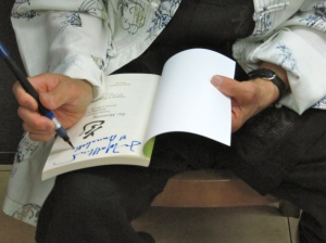 Book signing with a special calligraphic flourish. (My photo)