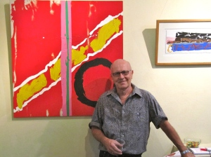 "Michael Stanley with his painting ""Le Rouge"" (My photo)"