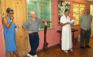 Fellow artist and former Vice Principal of the Edna Manley College of the Visual and Performing Arts Hope Brooks introduces the Stanleys' exhibition on the verandah of the Grosvenor Gallery. At right is gallery owner and art collector Douglas Reid. (My photo)
