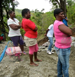 Women construction workers take a break, arms folded: Somerset.