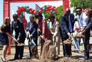 Prime Minister, the Most Hon. Portia Simpson Miller (fourth left) on Wednesday, February 27, broke ground for the construction of a Cardiac Wing at the Bustamante Hospital for Children. Other persons participating in the ground breaking are: (from left) Executive Director of Chain of Hope, Emma Scanlan; Chairman of the South East Regional Health Authority (SERHA), Lyttleton Shirley; CEO, Digicel Jamaica, Andy Thorburn; Her Excellency the Most Hon. Lady Allen; Minister of Health, Dr. Fenton Ferguson; artiste and philanthropist, Orville 'Shaggy' Burrell and Vice President, Sales and Investment Services, Sagicor Investments Ltd. Ms. Tar Nunes. (Photo: Jamaica Information Service)