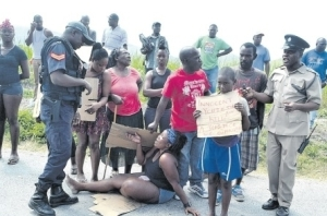 Residents protest the killing of three men by the police in Shrewsbury, Westmoreland. (Photo: Phillip Lemonte/Jamaica Observer)