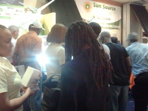 Let there be light... Customers crowd one solar lighting booth. (My photo)