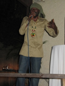 "Rastakura performs Mutabaruka's ""Dis Poem"" at Bookophilia. (My photo)"