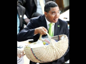 Opposition Leader Andrew Holness with his shopping basket in Parliament last week. (Photo: Gleaner)