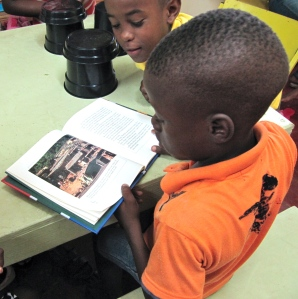 Boys at the Trench Town Reading Centre discuss a book about Nelson Mandela on Mandela Day last year. (My photo)