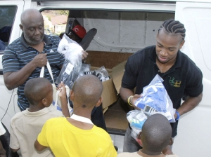 Athlete Yohan Blake distributes goods at Mount Olivet Boys' Home. (Photo: Gleaner)