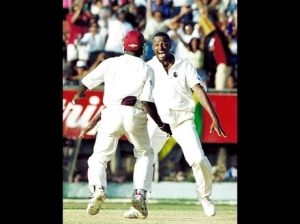 Courtney Walsh (right) celebrating his world record-breaking Test wicket against Zimbabwe on March 27, 2000 at Sabina Park. (Photo: Gleaner)