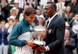 Usain Bolt presents the trophy to Rafael Nadal at the French Open today. (Photo: Matthew Stockman/Getty Images)