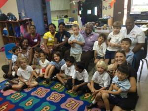 Kindergartners at the American International School of Kingston (AISK) in discussion with Eve for Life's Joy Crawford (in purple) at the school. (Photo: Eve for Life)