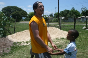 A member of the Delta Upsilon fraternity from a college in Oregon meets a young Jamaica while working at a school in Westmoreland. (Photo: Delta Upsilon Fraternity Blog)