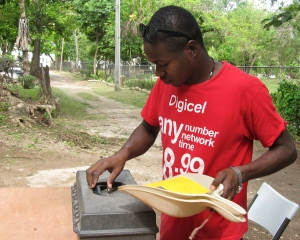 Vice President of UWI's History and Archaeological Society Adrian Reid packs up his things.