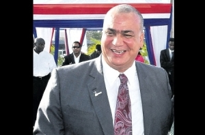 Junior Minister Richard Azan looks happy! No pressure... (Photo: Jamaica Observer)