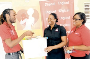 Nadine Bigby Swaby (centre), advocacy officer for Eve For Life, receives toys and other items donated by members of the Digicel Volunteerism Club Tadmar Moore and Marcia Sewell. (Photo: Lionel Rookwood/Jamaica Observer)