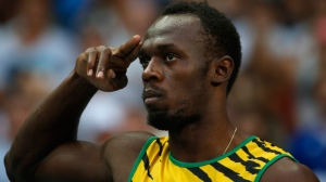 Saluting the fans: Darling Mr. Usain Bolt gestures before competing in a men's 100-metre heat at the World Athletics Championships in the Luzhniki stadium in Moscow on Saturday. (Matt Dunham/Associated Press)