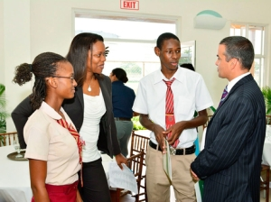 President of Junior Achievement (JA) Jamaica, Alphie Mullings-Aiken (second left), and board member Paul Lalor (right) chat with JA Alumnis, Callia Smith (left) and Martin Jarrett (second right). - (Photo: Janet Silvera/Gleaner)