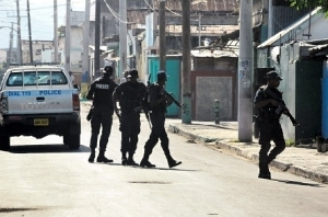 Police patrol West Kingston streets earlier this month. (Photo: Bryan Cummings/Jamaica Observer)