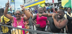 Jamaicans celebrate Shelly-Ann's win in Half Way Tree, Kingston. (Photo: Jamaica Observer)