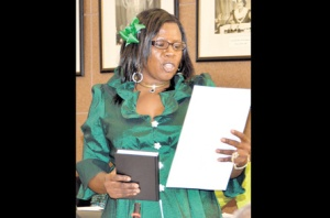 The Jamaica Labour Party's Beverly Prince, who won last Thursday's by-election in the Cassia Park Division of the Kingston and St Andrew Corporation, takes the oath of office at Tuesday's monthly meeting of the council at its Church Street chambers in downtown Kingston. There seem to be problems within her party, though. (Photo: JIS)