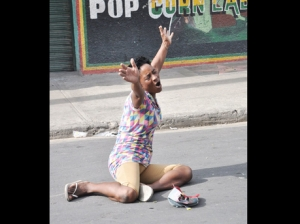 """Joy"" grieves over the death of her son, seventeen-year-old Steve ""Frenchie"" Allen, who was killed by the police in Denham Town, west Kingston, on August 17, 2013. (Photo: Jermaine Barnaby/Gleaner)"