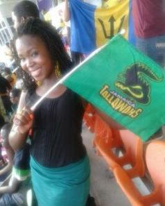 Cricket lovely cricket: Young Kemesha Kelly waves the Jamaica Tallawahs flag at Sabina Park. (her Twitter photo)