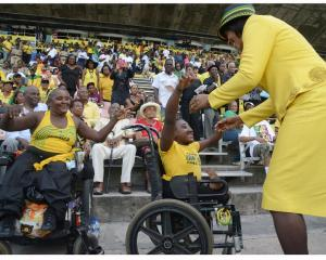 Prime Minister Portia Simpson Miller greets disabled Jamaicans at the Independence Day celebrations. (Photo: Gleaner)