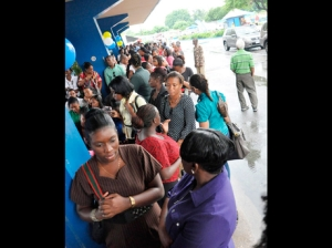 Trained teachers gather outside the Ministry of Education during a job fair in Kingston yesterday. (Photo: Jermaine Barnaby/Gleaner